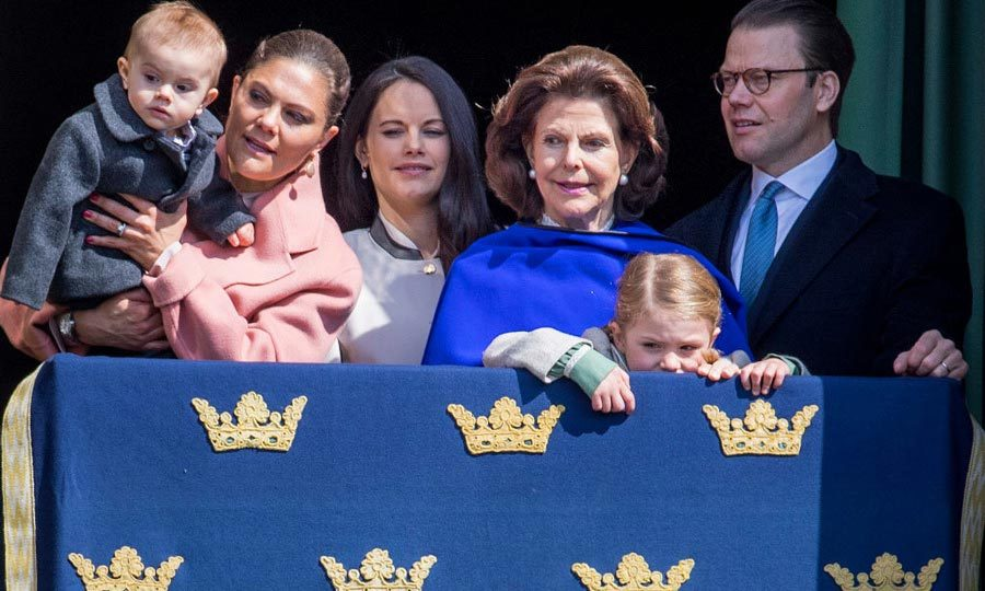 A curious Oscar peered over the ledge during his grandfather King Carl Gustaf's birthday celebration in April 2017.