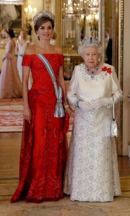 During the state banquet - Queen Letizia stood next to Queen Elizabeth in a beaded red off-the-shoulder gown by Felipe Varela with a dazzling tiara that was once owned by Queen Sofia.