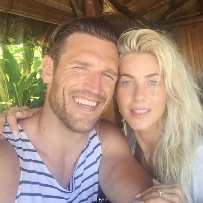 "Julianne shared a series of sweet snaps from her tropical honeymoon., including this one captioned, ""Brunchin' with my huzzzbin.""