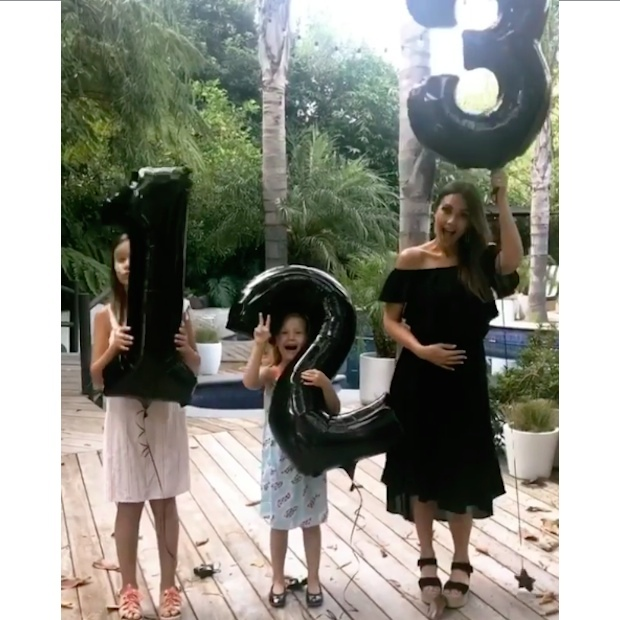 Surprise! Jessica Alba received some help from her daughters to share the happy news that she and husband Cash Warren are expecting their third child together. 