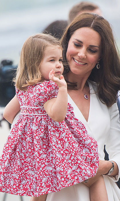 She came into the world two years ago, and has since been charming the world with her sweet nature. On Monday, all eyes were on Princess Charlotte as she emerged from a private plane in her mother's arms at Warsaw airport, ahead of the Duke and Duchess of Cambridge's five-day tour of Poland and Germany. Here at HELLO! Online, we have decided to take a closer look at Kate's mini-me, and reveal how little Charlotte is growing up to be just like her mum. 
