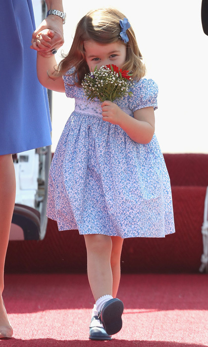 The family traveled to Berlin where the two-year-old received her first bouquet on July 19. Charlotte immediately smelled the lovely flowers as they made their way from the plane to continue on with their activities in Germany.
