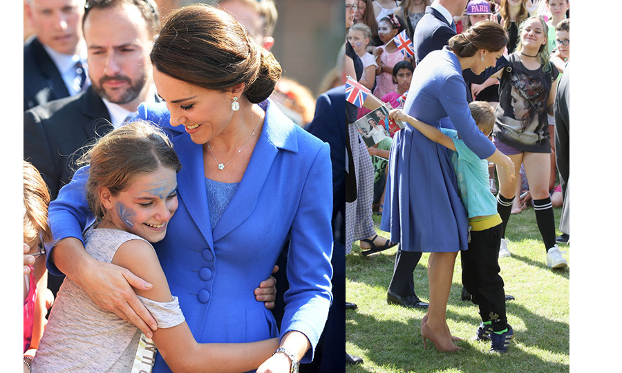 It was hugs all around when the Duchess of Cambridge the Strassenkinder children's charity in Berlin. Kate was happy to greet all the kids with open arms.