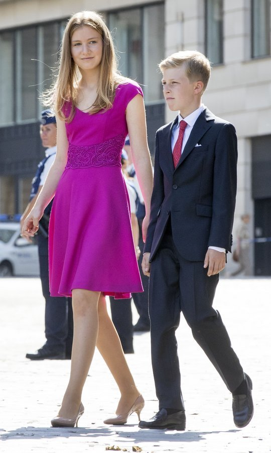 Fifteen-year-old Princess Elisabeth, who is heir to the throne, arrived alongside her little brother Prince Emmanuel, 11, who looked as dapper as his father the king wearing a suit and tie.