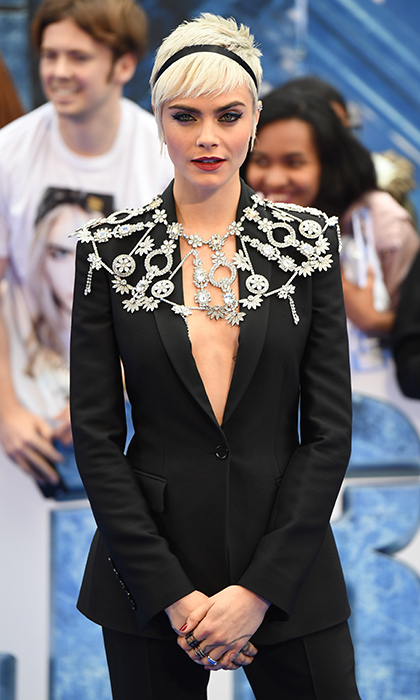 Cara Delevigne wore a custom Burberry suit with a bespoke vintage-inspired crystal capelet to the European debut of Valerian and The City of a Thousand Planets in London on July 24.