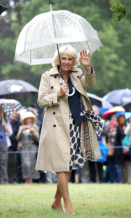 Camilla, Duchess of Cornwall showed the chic practicality of a Burberry trench at the Sandringham Flower Show on July 26.