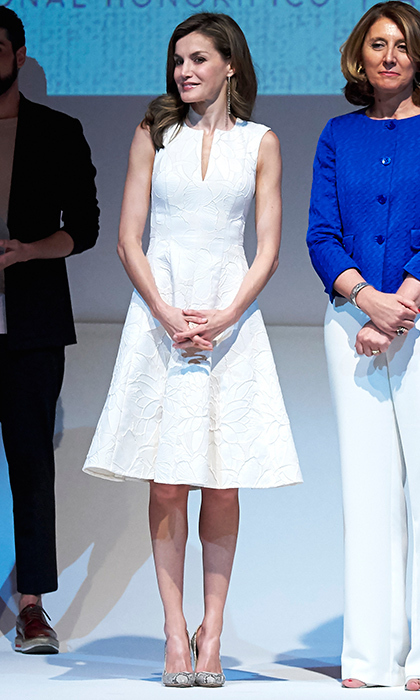 Queen Letizia wore summer's hottest style – the little white dress, this time by Carolina Herrera – to the National Fashion Awards 2017 at the Costume Museum in Madrid, Spain. 