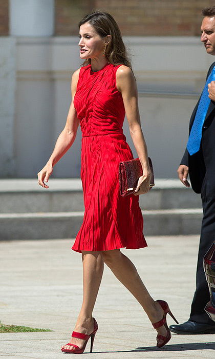 Also opting for head-to-toe red was Queen Letizia, in a Nina Ricci dress for an outing in Malaga, Spain on July 24. 