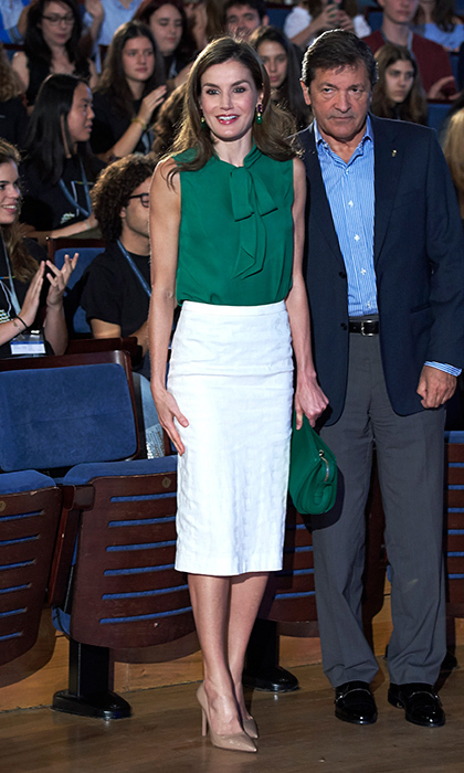Queen Letizia donned one of her favourite wardrobe pieces, a pencil skirt, with a pussy bow blouse in green and purse to match. The monarch's wife was at the opening of the International Music School's summer courses in Oviedo, Spain on July 21.