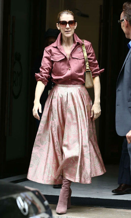 On Aug 2, Celine looked pretty in head-to-toe pink as she left her Paris hotel. The mother of three rocked a silk blouse and floral skirt by Rochas. 