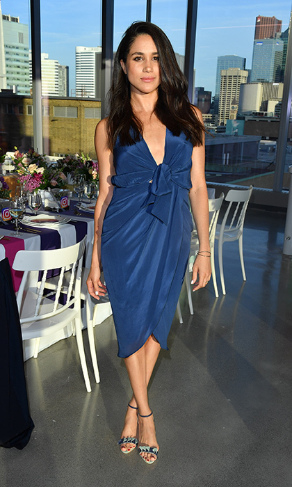 Blue is one of Meghan's fave hues – here she is in a silk halter dress in a shade that is also favoured by the Duchess of Cambridge.