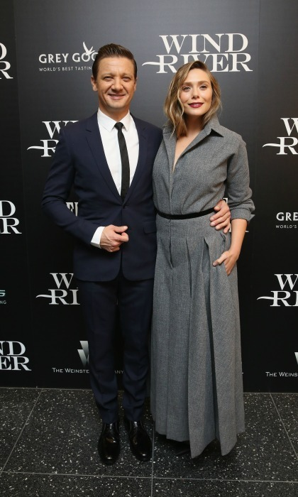 Stylish co-stars Elizabeth Olsen and Jeremy Renner attended the Weinstein Company with FIJI, Grey Goose, Lexus and NetJets screening of their film <em>Wind River</em> at The Museum of Modern Art in NYC on August 2. Elizabeth wore a long Dior coat dress while Jeremy kept things sharp in a tailored suit.