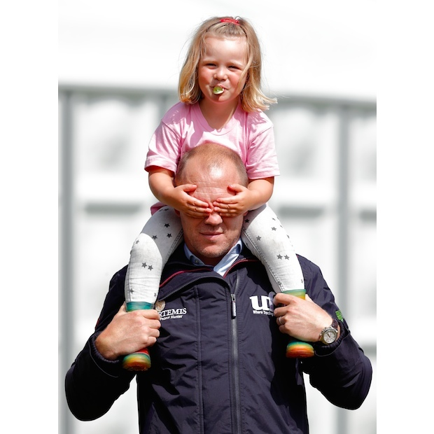 No peeking, dad! The toddler had some fun with her father Mike Tindall on the sidelines. 