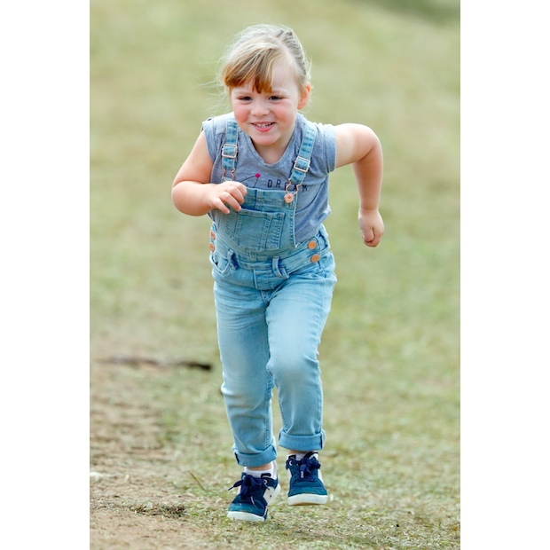 And she's off! The royal toddler looked simply adorable in denim overalls as she ran around the grounds of her grandmother Princess Anne's estate. 