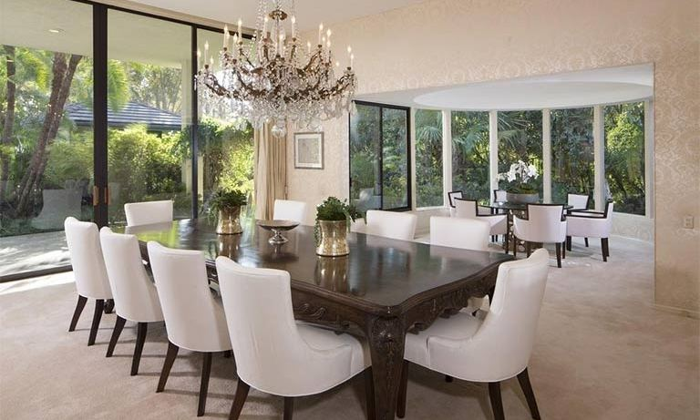 Adam and Behati will be able to entertain a number of guests at dinner parties; their new home has a huge dining room with two dining tables that could seat up to 15 people. The room is decorated in neutral tones with large windows and glass doors that lead out into the expansive gardens.