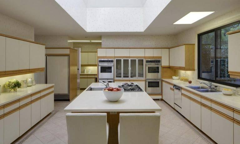 The kitchen also has plenty of room for the celebrity couple to prepare meals, with a vast number of cupboards lining each wall and an island with extra work surface space at the centre. It is fitted with modern appliances including two ovens, a large fridge and dishwasher.