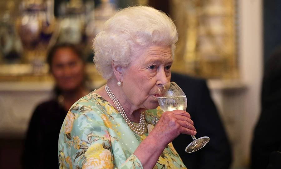 The Queen sipping a glass of wine.