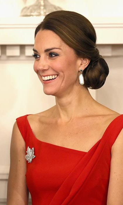 The Duchess accessorised her dress with the Queen's diamond maple leaf brooch
