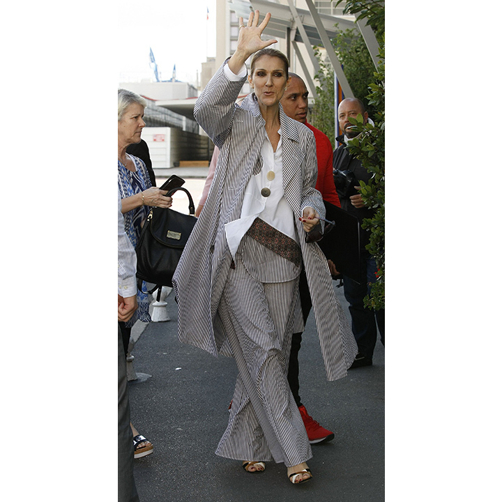 Celine waved goodbye to Paris on Aug 10 in oversized pinstriped pants and a matching trench. The singer looked remarkable in the Ports 1961 ensemble as she made her final fashionable exit from the Royal-Monceau Hotel. 