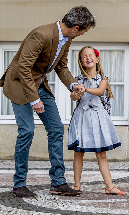 Princess Josephine of Denmark poses with her dad Prince Frederik on the first day of school.