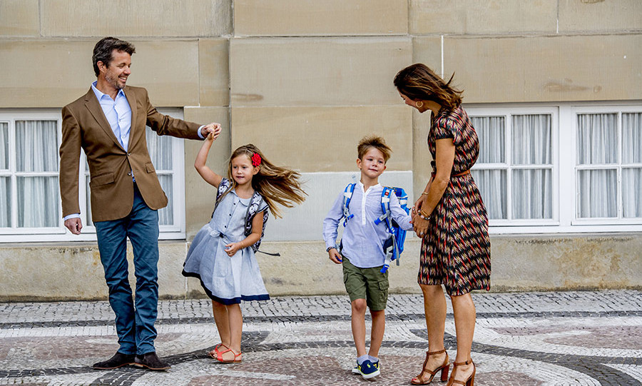 Prince Frederik and Princess Mary of Denmark pose with their twins Princess Josephine and Prince Vincent on their first day of school.