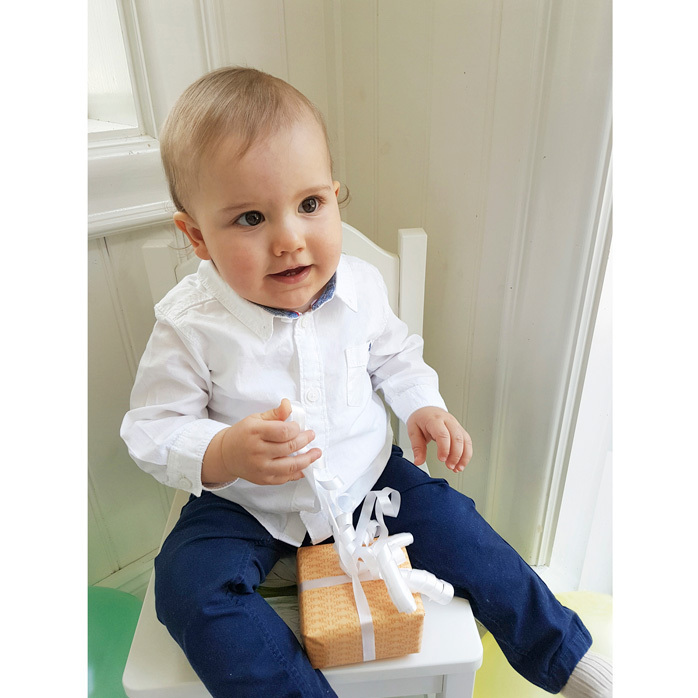 Prince Carl Philip of Sweden took this photo of his son Alexander for his first birthday. The little prince, who will become a big brother later in 2017, flashed a toothy smile as he held on to a present.