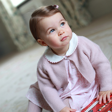 Princess Charlotte was pretty in pink for her first birthday portraits captured by mom, the Duchess of Cambridge.