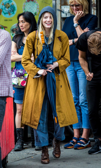 Emma Stone stayed dry as she filmed scenes for the new Netflix series <em>Maniac</em> in NYC on Aug 14.