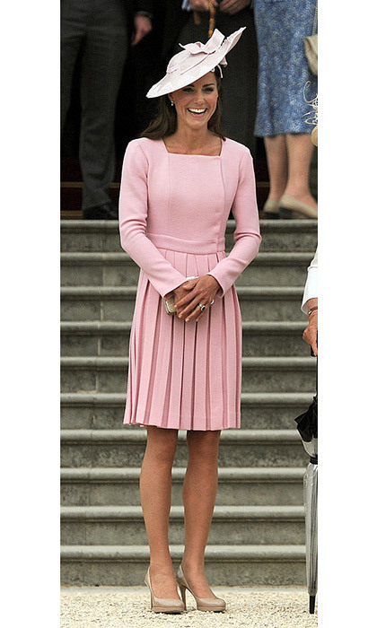 <p>Kate in a blush dress (paired with Jane Corbett hat) at a Buckingham Palace garden party in 2013.</p>