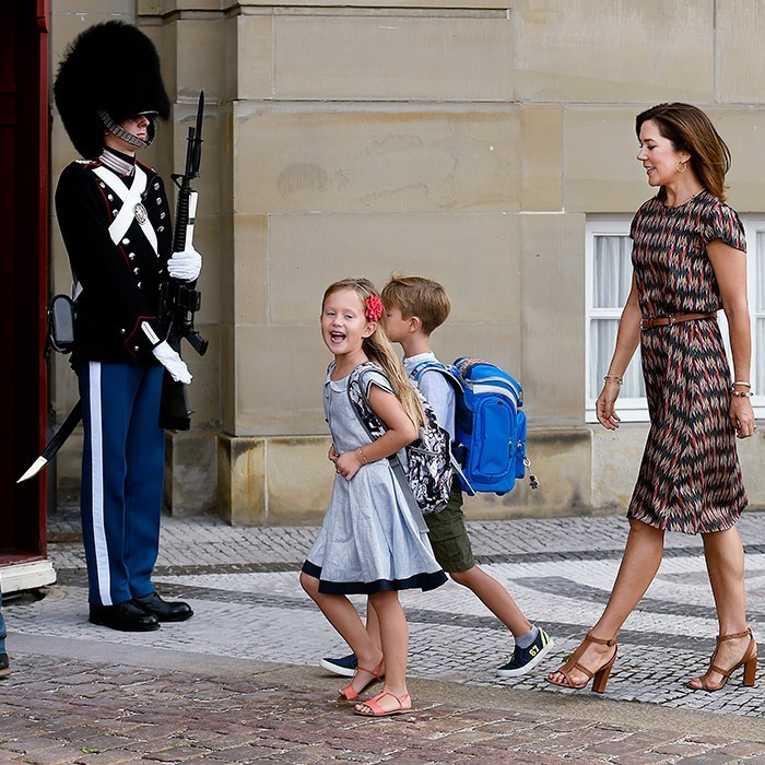 Followed by mom Princess Mary in the courtyard of Amalienborg Castle – and joined by twin brother Prince Vincent – Denmark's Princess Josephine looked thrilled to be headed off for her first day of school on Aug. 15.