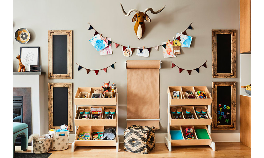 Rockwell will have no trouble organizing his belongings with all this shelf space available for him! A magnet board will be the perfect toy for the little one to experiment with, and the roll of paper could hone some serious drawing skills!
