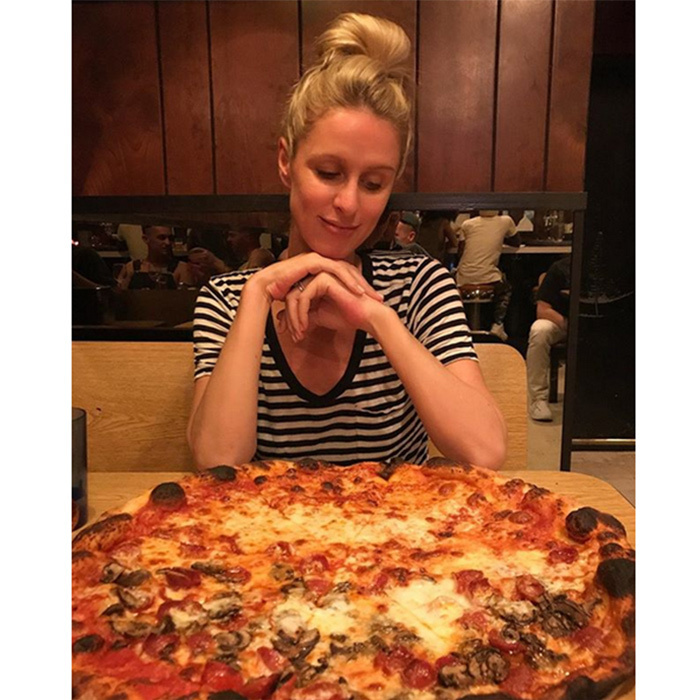 "Find someone who looks at you the way pregnant Nicky Hilton Rothschild looks at pizza! The 33-year-old shared this picture on her Instagram, captioning it: [Pizza emoji] is genuine happiness."" And we couldn't agree more.