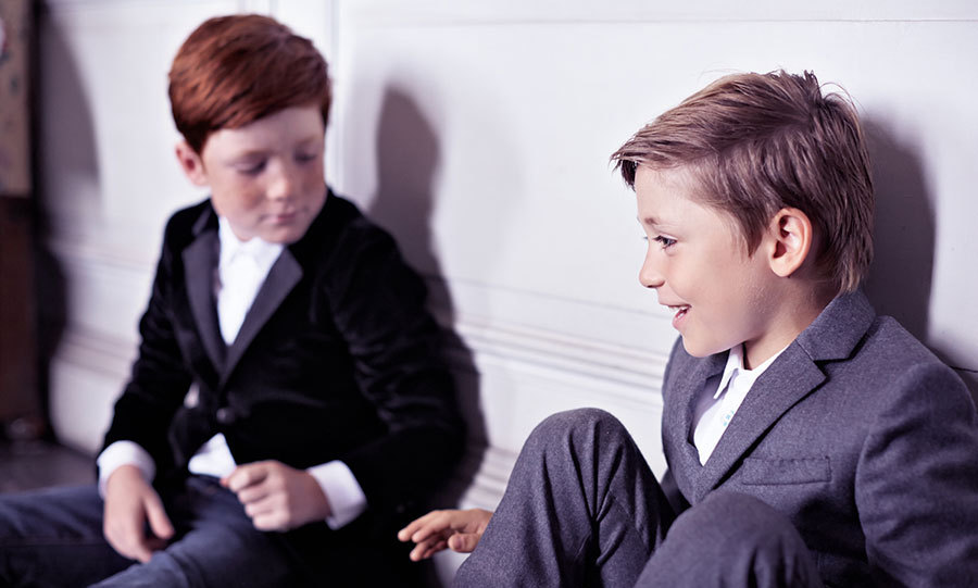 Don't these little boys look smart in these classic, yet comfortable suits? The model on the left looks daper in a velvent dinner jacket, a white shirt and casual jeans, while the model on the right wears a grey suit jacket teamed with a white shirt and co-ordinating grey flannel trousers.