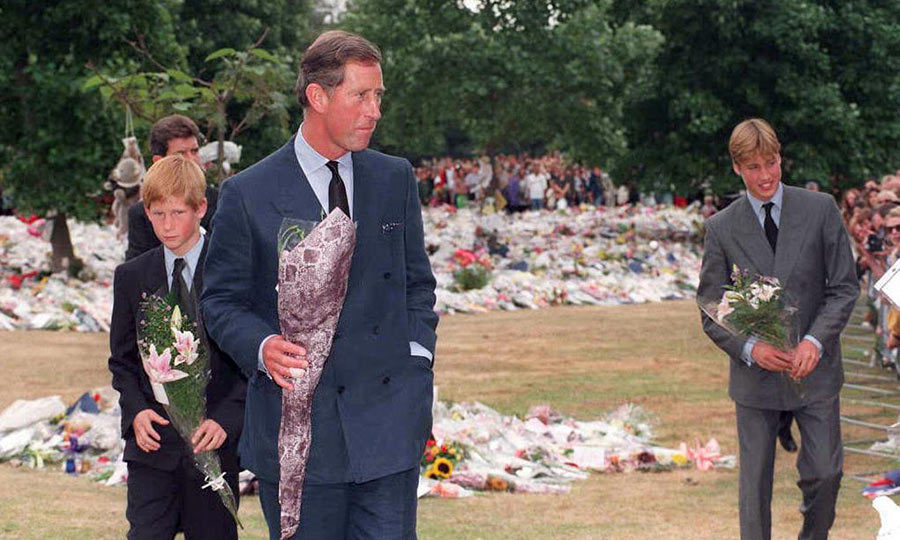 Prince Charles and sons Princes William and Harry place floral tributes to their mother, Diana, Princess of Wales, at Kensington Palace, her former London residence in 1997.