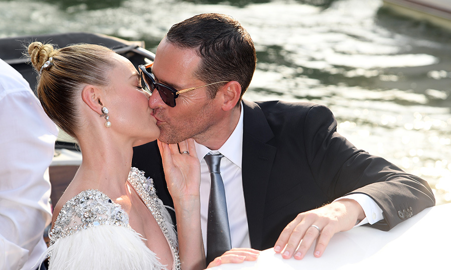 Kate Bosworth and Michael Polish stole a kiss en route to this year's festival. The actress dazzled in a glittery dress by Miu Miu and her hair slicked back into an elegant topknot bun. 
