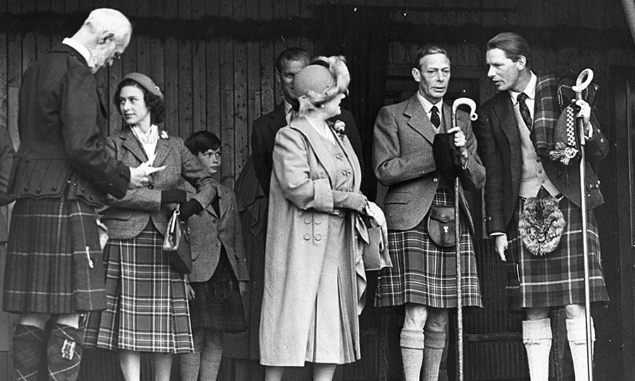 King George VI (second from right) and his wife Queen Elizabeth, along with Princess Margaret, entertained Captain Farqhuarson (far right) and the Marquis of Aberdeen (left) at the Gathering in 1951. 