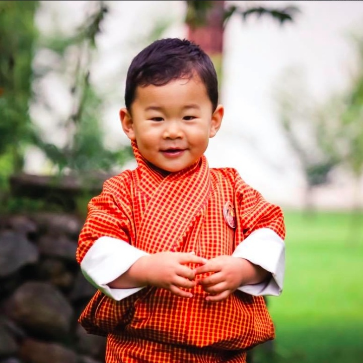 Little Jigme is all ready for autumn in an adorable new portrait released on Aug 31. 
