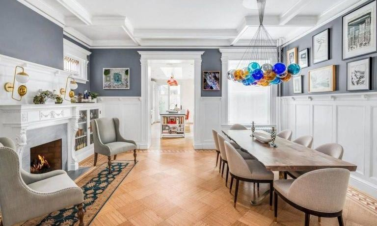 Also on the ground floor of the property is a formal panelled dining room, complete with a long dining table to seat eight people, a gas fireplace and built-in glass cabinets. Numerous pieces of artwork are on display, while a distinctive colourful chandelier is the focal piece of the room.