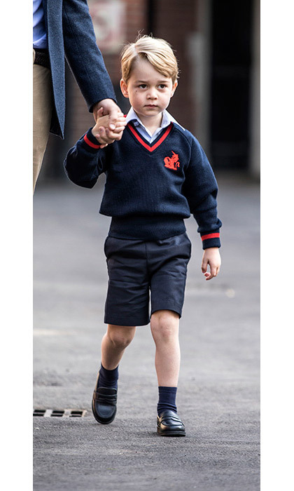 "<p>George could have been any other pupil, looking smart in his navy shorts, pale blue shirt and navy and red jumper, emblazoned with the <strong><a href=""/royalty/02017032934451/details-prince-george-new-school"">Thomas's Battersea</a></strong>'s school logo. </p>