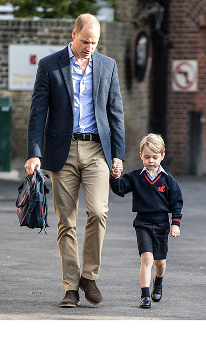 "<p><strong><a href=""/tags/0/prince-george/"">Prince George</a></strong> is officially a pupil at Thomas's Battersea. The future King arrived for his first day of '<strong><a href=""/tags/0/school/"">big school</a></strong>' on Thursday morning, accompanied by his dad <strong><a href=""/tags/0/prince-william/"">Prince William</a></strong>. Sadly, his mother the Duchess of Cambridge was forced to stay at home at Kensington Palace as she battles severe morning sickness; <strong><a href=""/tags/0/prince-william-and-kate/"">William and Kate</a></strong>, 35, announced that they are <strong><a href=""/royalty/02017090438430/prince-william-kate-middleton-pregnant-third-baby%20/"">expecting their third child</a></strong> on Monday.</p><p>A palace spokesperson said: ""Unfortunately the <strong><a href=""/royalty/02017090438438/kate-middleton-hyperemesis-gravidarum-details/"">Duchess of Cambridge remains unwell</a></strong>, and will not be able to accompany Prince George on his first day of school. The Duke of Cambridge will drop off Prince George this morning as planned.""</p><p>Looking a little apprehensive, George walked through the gates of Thomas's Battersea just before nine o'clock. The young royal, who turned four in July, looked adorable in his new school uniform: navy shorts, a blue V-neck jumper emblazoned with the school's emblem, a light blue polo shirt, blue socks and black shoes. He arrived holding hands with his dad, who was carrying his red and blue school rucksack.</p>