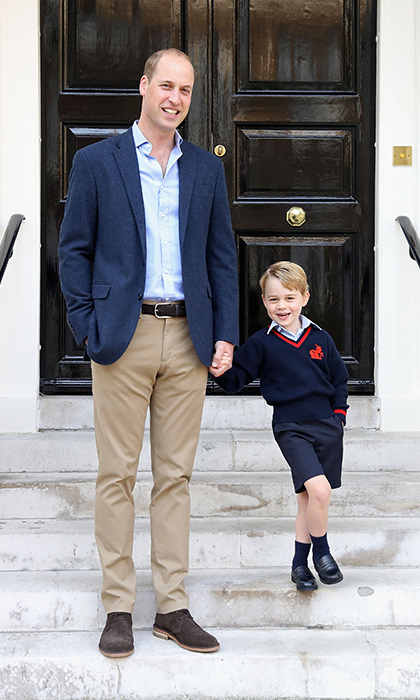 <p>Prince William and Prince George pose just before George starts school at Thomas's Battersea.</p>