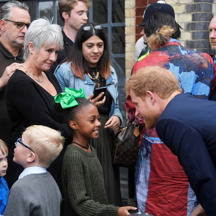 <p>Prince Harry was his charming self as he met a little girl outside the September 5 visit to the newly established Royal Foundation Support4Grenfell community hub.</p>