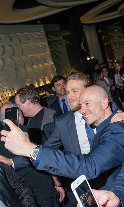 Charlie Hunnam posed for selfies all night at the Grey Goose bash for his film <em>Papillon</em>. The event, hosted by Nordstrom Supper Suite, was held at Yorkville hotspot STK. 