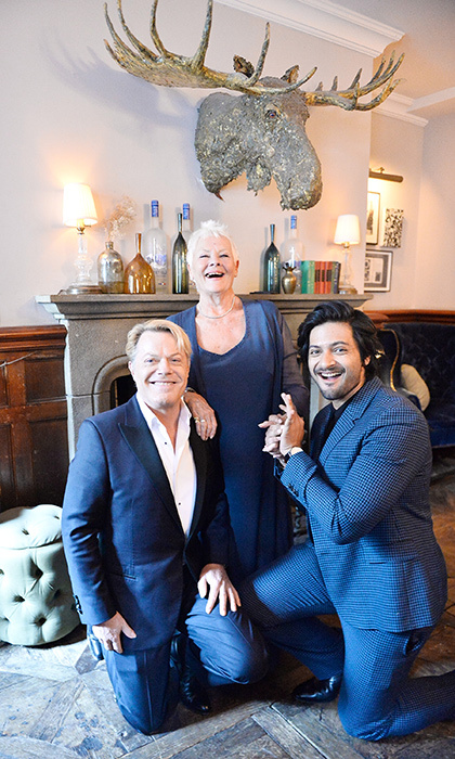 Dame Judi Dench was all smiles as she joined her co-star Ali Fazal and director Stephen Frears for a cast photo. 