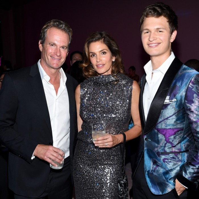 Ansel Elgort didn't mind third-wheeling with hot couple Rande Gerber and Cindy Crawford at the Tom Ford Spring/Summer 2018 Runway Show After Party on September 6. The Baby Driver star looked sharp in a purple-toned suit, as he stood next to the sparkling couple.