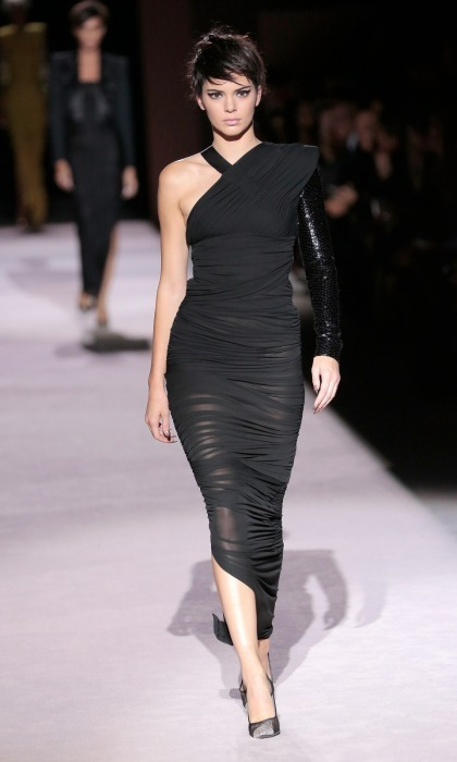 Gigi's bestie Kendall Jenner wore a black off-the-shoulder version of the 2018 Tom Ford design. The 21-year-old's hair was also similar, both being faux chops which had twisted each model's hair and used hairspray. Of course, the style brings up visions of another Jenner: Kendall's mom.