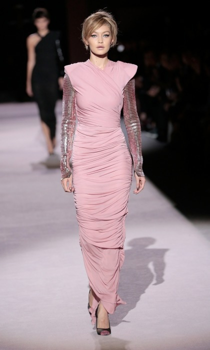 Gigi Hadid walked the Tom Ford runway at the Park Avenue Armory on September 6, rocking a sequined-sleeved, pink ruched gown. The model also showed off a sleek hairstyle, courtesy of Orlando Pita, which really turned heads.
