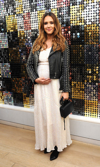 Jessica Alba cradled her baby bump at the Rebecca Minkoff presentation at the designer's Soho store.