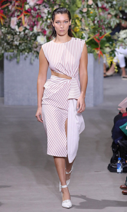 Bella Hadid wore a cut out dress down the Jason Wu runway.