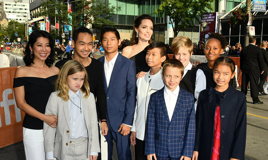 Loung Ung, Vivienne Jolie-Pitt, Maddox Jolie-Pitt, Pax Jolie-Pitt, Angelina Jolie, Kimhak Mun, Knox Jolie-Pitt, Shiloh Jolie-Pitt, Zahara Jolie-Pitt and Sareum Srey Moch attend the First They Killed My Father premiere during the 2017 Toronto International Film Festival at Princess of Wales Theatre on September 11, 2017 in Toronto, Canada.